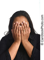 woman covering his face on black background