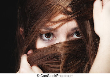 woman covers the face by long brown hairs - Loneliness ...