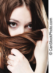 woman covers the face by long brown hairs - Loneliness...