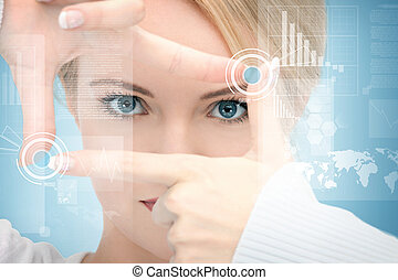 woman creating frame with fingers and working with virtual...