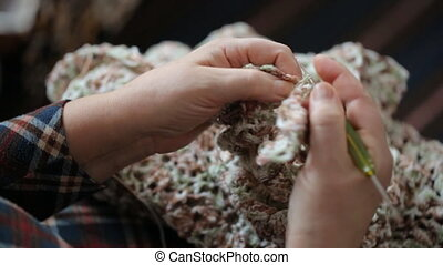 Woman crocheting lacy dress closeup