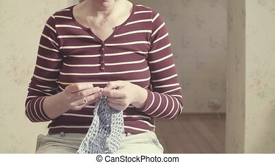 Woman crocheting vest - Woman in the room crocheting vest
