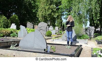 woman cross cemetery