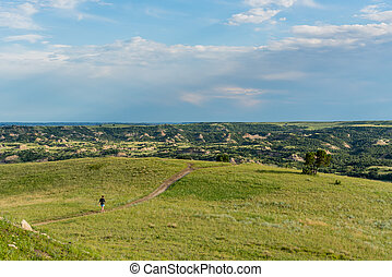 Woman Crosses Trail On The Prarie