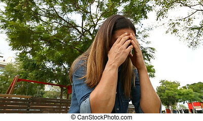 Woman crying in a park - Desperate woman crying in a park