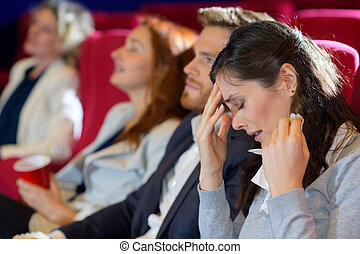 woman crying in cinema audience