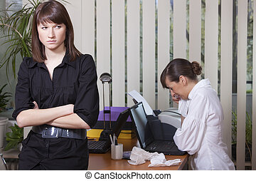 woman crying in office - female rivals - woman crying in a...