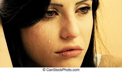 Woman crying slow motion - Beautiful woman with one tear on...