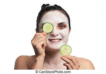 woman cucumber mask