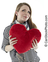 Woman cuddling with a red heart pillow