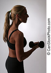 Woman curling dumbbell