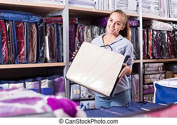 Woman customer choosing for beautiful bed linen - Happy ...