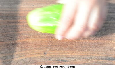 woman cut cucumber knife