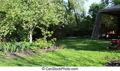 woman cut lawn bower