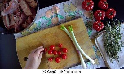 Woman Cuts Cherry Tomatoes