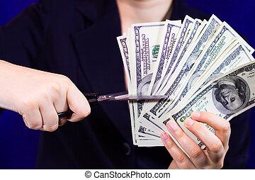 Woman cuts dollar scissors - Businessman cuts fan of dollars...