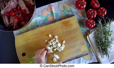 Woman Cuts Spring Onions
