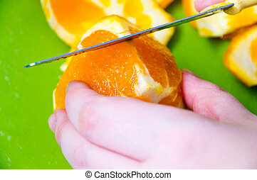 woman cutting an orange