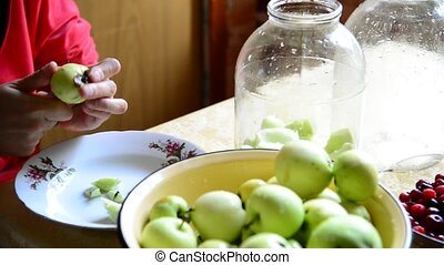Woman cutting apples for cooking canned compote