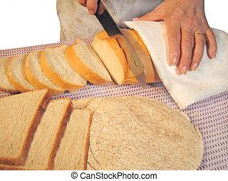 cutting bread - woman cutting bread