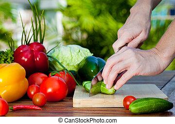 woman  cutting cucumber  knife