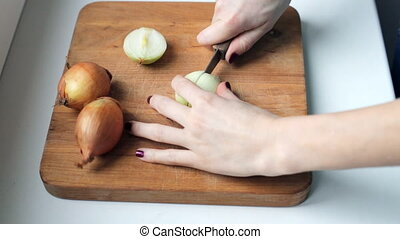 Woman cutting onion