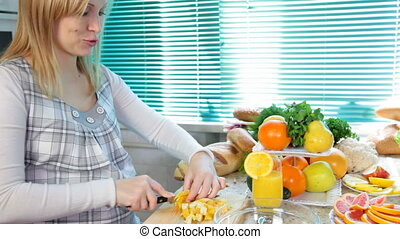 woman cutting orange