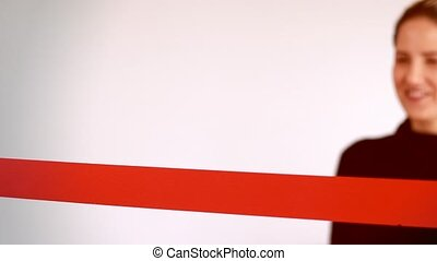 Woman cutting red ribbon with copy space - Woman cutting red...