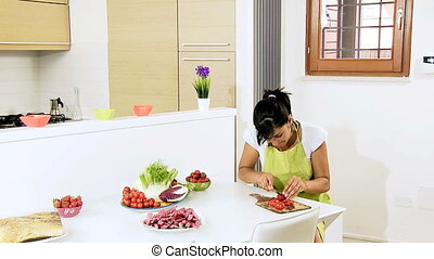 Woman cutting tomatoes for salad