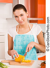 Woman cutting vegetables in a kitchen