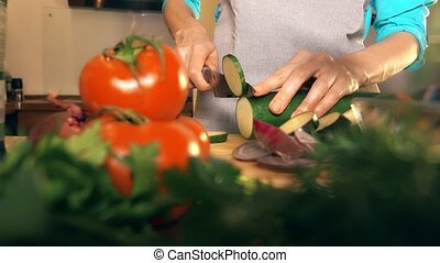 Woman cutting zucchini. Cooking homemade ratatouille. ...