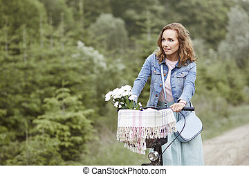 Woman cycling in the park