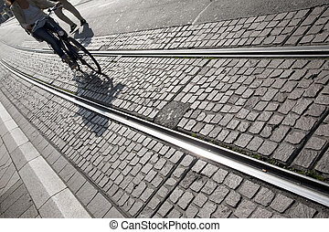 Woman Cycling on Tram Track, Geneva, Switzerland