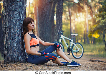 Cyclist resting under a tree