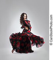 Woman dance in gypsy red and black costume
