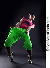 woman dancer against black background