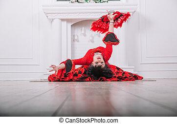 woman dancer in red dress performing folk Gypsy dance