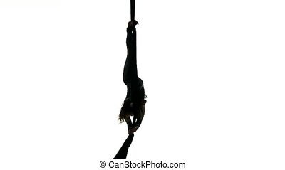 woman dancer on aerial silk, aerial contortion, aerial ribbons, aerial fabric in posing exercise