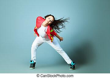 woman dancer - Modern girl dancing hip-hop at studio.