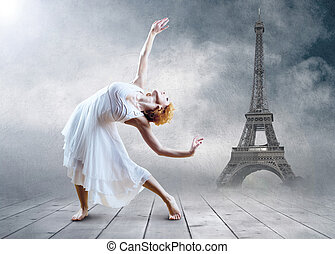Woman dancer seating posing on the Eiffel tower background -...