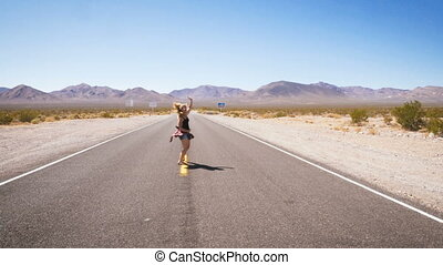 woman dancing alone on street in the middle of nowhere.