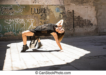 Woman dancing and performing outdoors