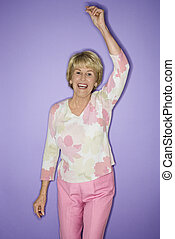 Woman dancing and smiling.