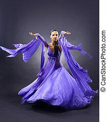 woman dancing, dark background