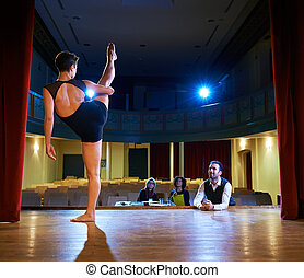 woman dancing for audition with jury in theater - Audition ...