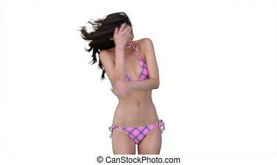 Woman dancing happily in her bikini