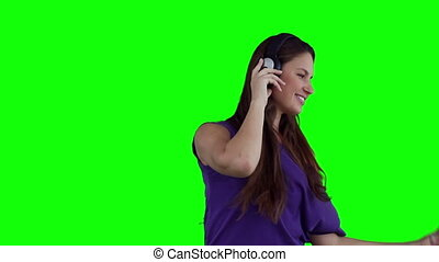 Woman dancing happily while wearing headphones