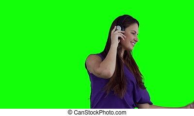 Woman dancing happily while wearing headphones