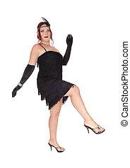Woman dancing in a black dress