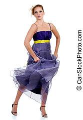 woman dancing in purple lace dress